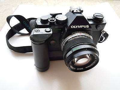 how to put film in a camera olympus